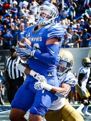 University of Memphis tight end Joey Magnifico (top) hauls in a touchdown catch against UCLA defender Octavius Spencer (right) during first quarter action at The Liberty Bowl Memorial Stadium in Memphis, Tennessee., Friday, September 16, 2017.