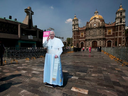 A life-size cutout of Pope Francis stands in the plaza