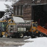 An end loader loads salt into a city of Oshkosh salt and plow truck on Tuesday after the Oshkosh area received six inches of snow overnight. City crews were busy plowing the roads and putting down salt Jan. 26, 2016.