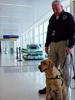 David Wills, of the Transportation Security Administration, and Riveriso patrol the concourse at Indianapolis International Airport on Feb. 3, 2012. Officials are beefing up security at the airport, including adding more bomb-sniffing dogs, after a terrorist attack at an airport in Istanbul, Turkey.