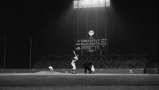 Sandy Koufax delivers a pitch to Chris Krug of the Cubs, the first batter in the ninth inning of Koufax's perfect game.