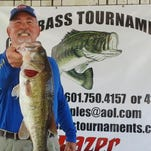 Tom Pope shows off the big bass weighing 5.79 pounds from Saturday's CGM Bass Tournaments Barnett Reservoir tourney.