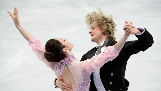 The USA's Meryl Davis and Charlie White perform their short dance during the figure skating ice dancing competition at the Iceberg Skating Palace during the Winter Olympics in Sochi, Russia,  Feb. 16, 2014.