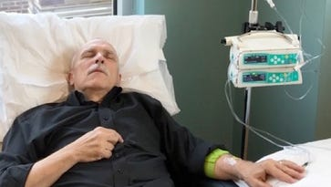 David Mitchell, founder of Patients for Affordable Drugs, is shown getting an infusion of drugs for his incurable blood cancer, multiple myeloma. .