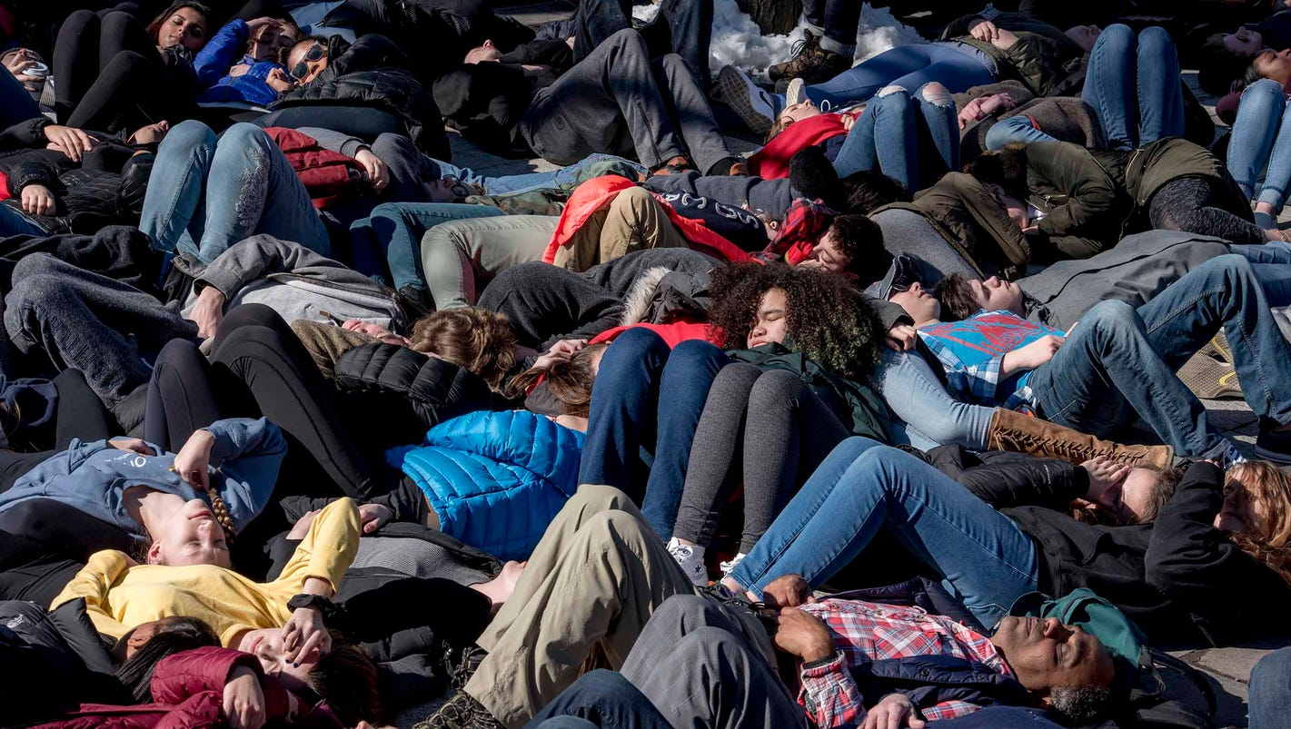 High school students stage 'Die-In' protest against guns in Ann Arbor
