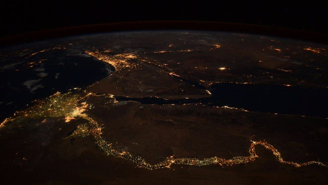 Nighttime lights along the Nile River in Egypt as seen from the International Space Station. The lights of Cairo are at the left while Israel's lights are at the top of the image.