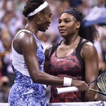 epa04921238 Venus Williams of the US (L) and Serena Williams of the US (R) embrace at the net after their quarterfinals match on the ninth day of the 2015 US Open Tennis Championship at the USTA National Tennis Center in Flushing Meadows, New York, USA, 08 September 2015. The US Open runs through 13 September, which is a return to a 14-day schedule. EPA/DANIEL MURPHY