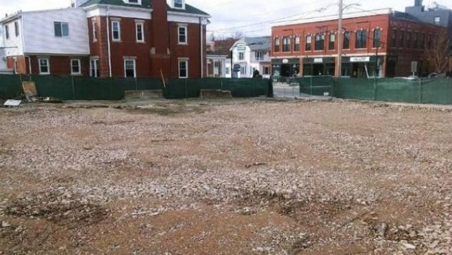 This vacant lot at 1 South Main St. in Natick is all that remains from last summer's fire that destroyed several businesses.