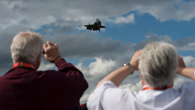 Plane enthusiasts photograph the F35 as it performs at the Farnborough International Airshow in Farnborough, Britain, on July 12, 2016.