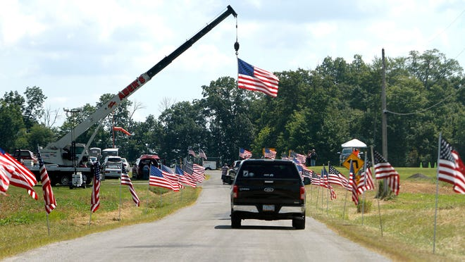Flags line the entry to the Veterans Appreciation Day on August 3, 2019 at the Ashland County Airport. This year's event has been canceled due to COVID-19 concerns.