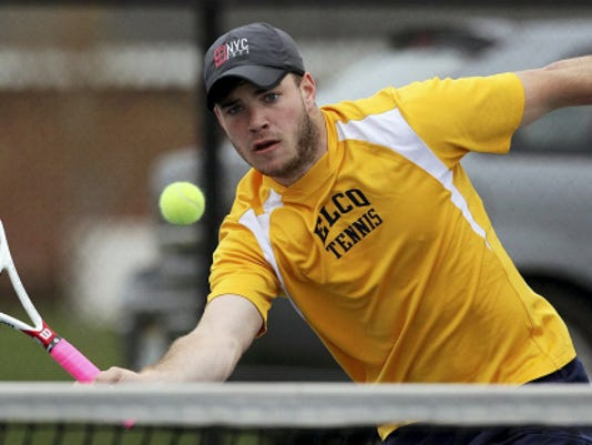 Elco's Adam Bahney, returns a shot to Lancaster Mennonite's Will Wanner, during the LL Boys Tennis Finals at Conestoga Valley High School Monday April 27, 2015.