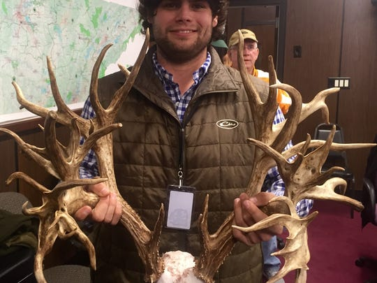 Stephen Tucker of Gallatin holds up the 47-point antlers