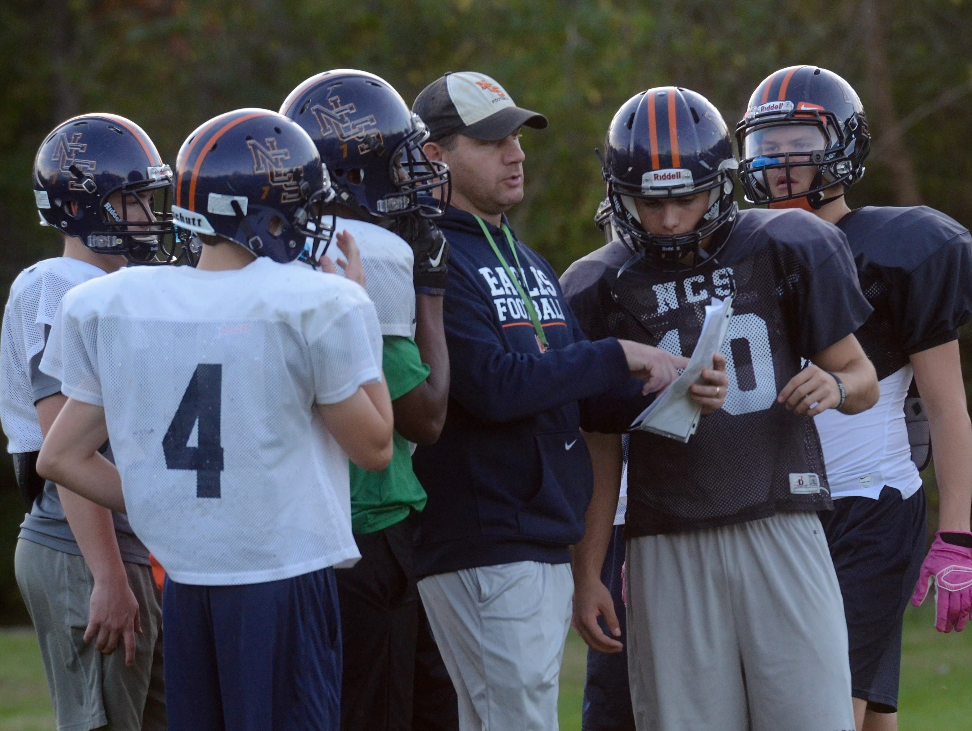 Nashville Christian coach Jeff Brothers (center) coaches his players during Wednesday's practice.