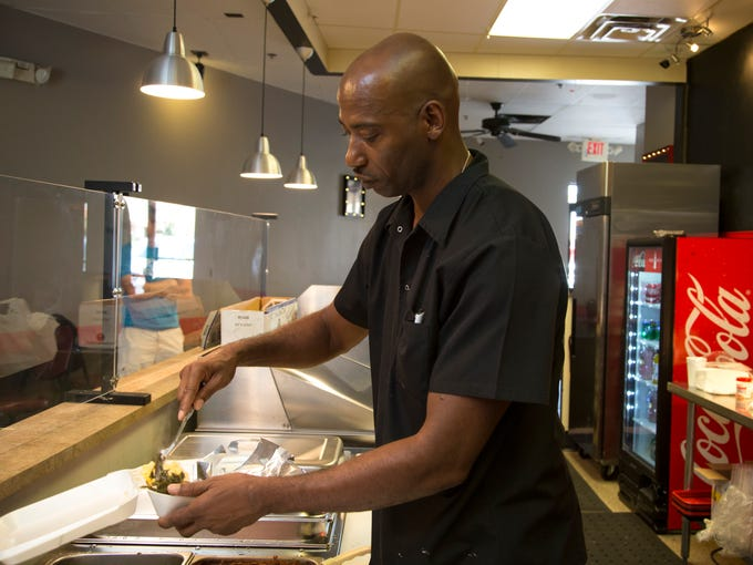 Antoine Smith works in the kitchen at Ibby's Fish and
