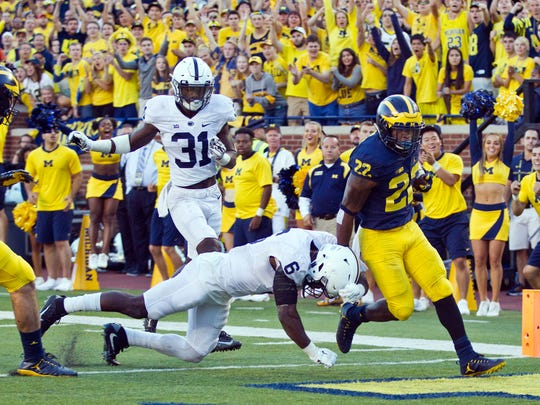 Michigan running back Karan Higdon (22) scores a 40-yard touchdown, defended by Penn State safety Malik Golden (6), in the fourth quarter at Michigan Stadium in Ann Arbor, Mich., Saturday.