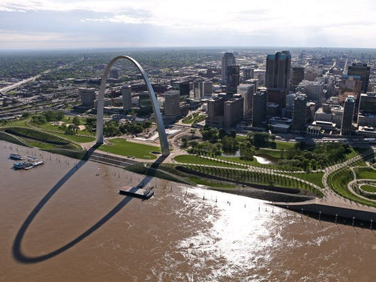 The swollen Mississippi River flows past the redesigned