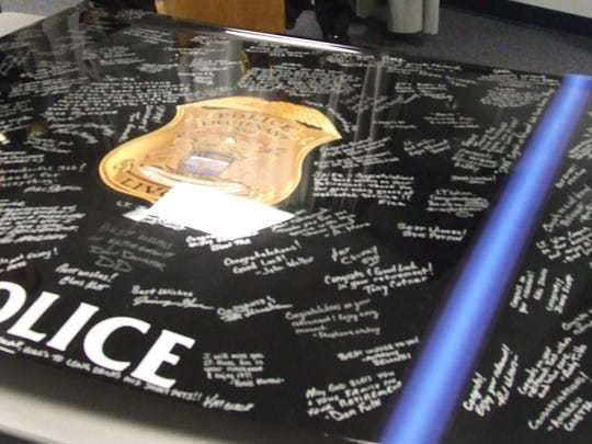 The police department presented Gregg Winn with the
