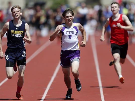 Mac Stahl, of Ozaukee, races Chris Snook, of Pittsville,