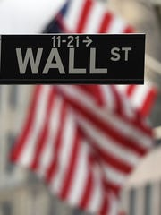 This file photo shows a Wall Street sign near the New
