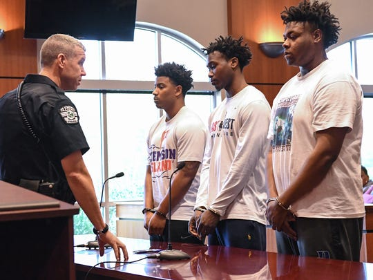 Charlie Bernard Fuller, left, Jadar Kentrell Johnson, middle, former Clemson football players and Quaven Maurice Ferguson, former Duke football, appear in Clemson Municipal Court in Clemson on Thursday. Each persons bond was set at  $25,000, with stipulations they could not make contact with the victims, leave the state, and wear GPS monitoring.