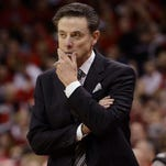 Louisville Cardinals head coach Rick Pitino stands on the sideline during a game against the Ohio State Buckeyes.