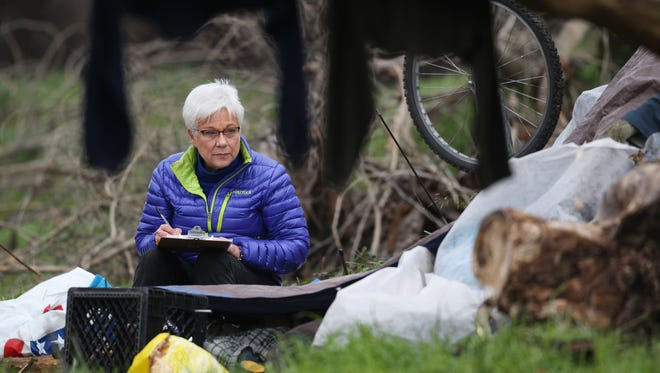 Judy Salter talks to a person in January 24, 2017 living in the Henderson Open Space in Redding during the Point In Time homeless count.