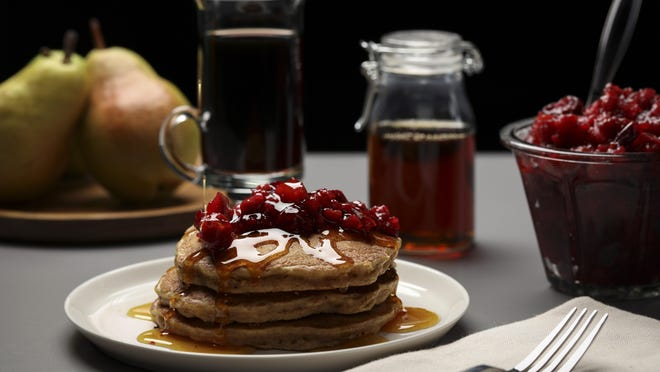 Pancakes with homemade cranberry and fig jam bring the feel of a luxurious weekend brunch to your table at home.