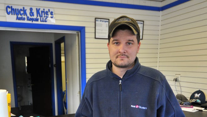 Co-owner Kris Spatz, of Wausau, poses for a photo Friday at Chuck and Kris's Auto Repair in Weston.