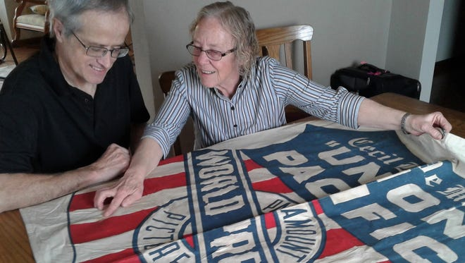 "This 80-year-old banner proclaiming the world premiere of the movie ""Union Pacific"" in Omaha in 1939 is displayed by Kalona residents Monica Miller and her husband Merlin.   Monica's prized family artifact will be featured on the popular ""Antiques Roadshow"" on Iowa Public Television April 30."
