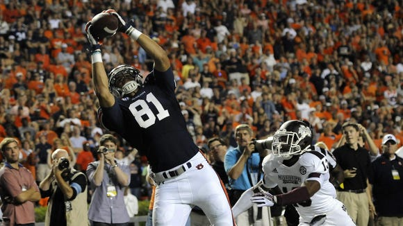 C.J. Uzomah caught just 22 passes in his last two years at Auburn, but the Cincinnati Bengals drafted him in the fifth round Saturday.