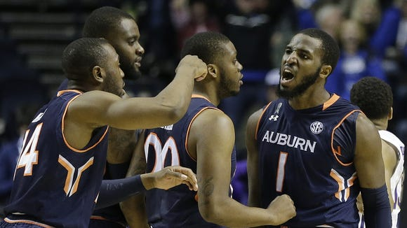 Auburn guard KT Harrell (1) celebrates with teammates  after hitting a three-point shot in the closing seconds of regulation in the SEC quarterfinal game against LSU.