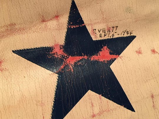 Names and presumably enlistment dates are handwritten next to each of the three stars on a World War II service flag discovered by Mary Fisher at a rummage sale. The name by the third star is Evertt, with the date Sept. 5, 1944.