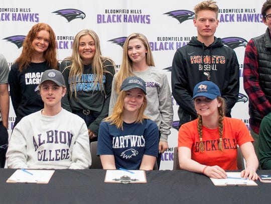 A proud group of 11 student-athletes from Bloomfield