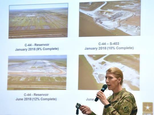 Lt. Col. Jennifer Reynolds, Deputy District Engineer for South Florida, from the U S Army Corps of Engineers, discusses photos of the C-44 Reservoir at the end of her presentation on Lake Okeechobee and the St. Lucie River during a Rivers Coalition meeting Thursday, June 28, 2018, at the City of Stuart Commission Chambers. More than 100 attended the 90-minute meeting, providing an update to the public on the algae situation affecting Lake Okeechobee and the St. Lucie River. To see more photos, go to TCPalm.com. CQ Jennifer Reynonlds