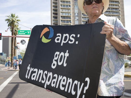 Ken Gray protests outside the shareholder meeting on