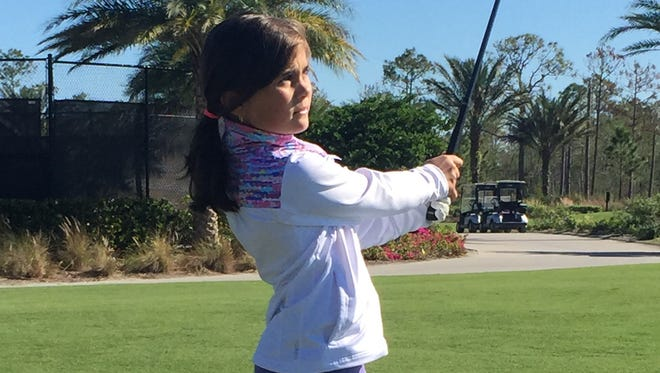 Naples 9-year-old Jensi Krampel, shown at a recent practice session at Esplanade Golf & Country Club, will play in the Drive, Chip and Putt National Finals on Sunday at Augusta National Golf Club in Augusta, Ga.