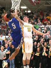 Colonel Crawford's Brody Martin swats at the ball during the Division IV District final against Mansfield St. Peter at Willard High School on Friday.
