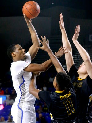 MTSU's Nick King (5) goes up for a shot during the game against Southern Miss on Saturday.