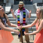 Tiffany Brosh, left, and Laurin Locke of Pearl, Miss.,become the first legally-married same-sex couple in the Jackson metro area following a ceremony officiated by Justin MCreary, center, of the Unitarian Universalist Church of Jackson outside the Hinds County Courthouse in Jackson, Miss.,on Monday, June 29, 2015. The attorney general's office authorized the issuance of licenses Monday morning countering a statement made on Friday that delayed implementation of legal marriage in the state.