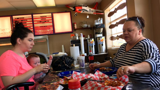 Crissy Beecham, 6-month-old Aiden Beecham and Denise Sircy eat at Sky Burgers Diner, which opened earlier this month at the Sumner County Regional Airport.