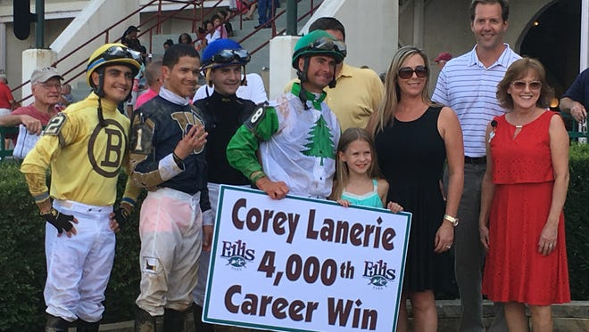 Corey Lanerie (9) celebrates winning his 4,000th career race with his family, riding colleagues and Ellis Park representatives at Ellis Park on Sunday, July 31, 2016.