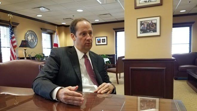Florida Senate President Joe Negron, R-Stuart, talks to reporters inside his Capitol office on April 13, 2017.