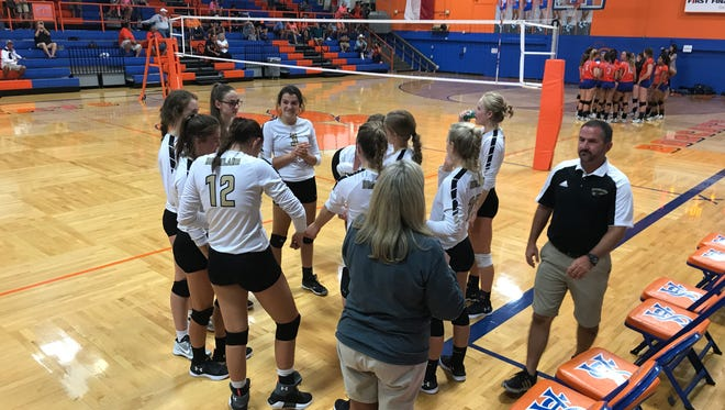 Bushland High School awaits the presentation of awards after winning the Gold Bracket of the Nita Vannoy Memorial volleyball tournament Aug 19 at Central's Babe Didrikson Gym.