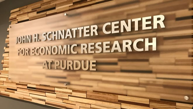 A sign bearing the name of John Schnatter, founder of Papa John's pizza chain, greets visitors to the third floor of Krannert School of Management at Purdue. In April, Purdue renamed its Center for Economic Research at Purdue for Schnatter, who donated $8 million to the university.