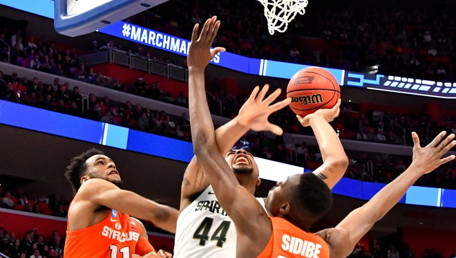 Nick Ward gets double-teamed by Syracuse on Sunday.