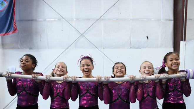 Gymnasts hang out after practice at Island Twisters Gymnastics on Feb. 16. The gymnasts brought back 17 medals from the 40th Annual Aloha Gymfest meet in Kailua, Hawaii, held Jan. 14-17 — seven gold, six silver and four bronze.