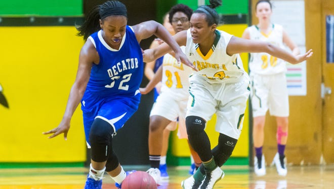 Stephen Decatur guard Dayona Godwin (32) steals the ball for Mardela forward Aerionna Joynes (12) against Mardela on Tuesday, January 12th at Mardela.