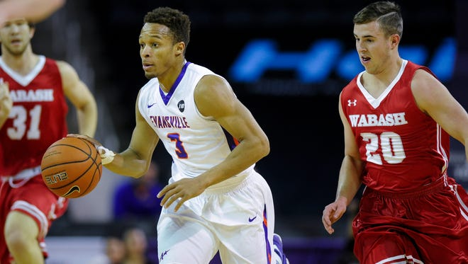 Evansville guard Jaylon Brown (3) drives past Wabash guard Isiah Stafford (20) during their game at the Ford Center in Evansville, Wednesday, Nov. 30, 2016. Evansville beat Wabash 83-39.
