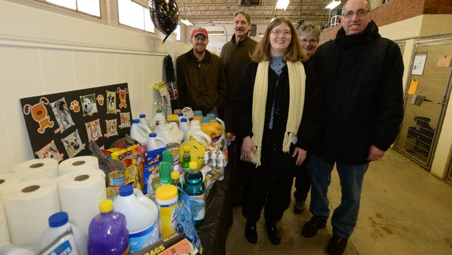 Jason Truitt (from left), Bill Engle, Millicent Martin Emery, Louise Ronald and Mike Emery with items donated to the HELP the Animals Shelter in Richmond as part of the 12 Months of Giving.