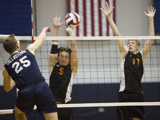 Dallastown's Avery Terroso, left, attempts to hit the ball past Central York defenders Drew Anderson, center, and Braden Richard. Central York defeated Dallastown 3-2 in the YAIAA boys' volleyball tournament quarterfinals at Dallastown Area High School, Monday, May 16, 2016.
